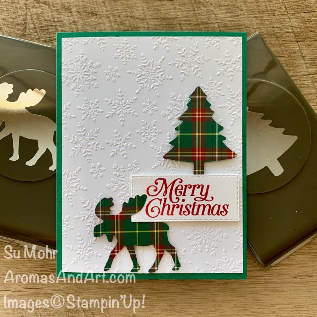 By Su Mohr for cts; Click READ or VISIT to go to my blog for details! Featiring: Moose Punch, Pine Tree Punch, Winter Snow embossing, Plaid Tidings Designer Paper, Stitched Rectangles Dies; #christmascards #plaidpaper #holidaycards #moose #mooseoncards #christmastrees #treesoncards #embossing #snowoncards #handmadecards #handcrafted #diy #cardmaking #quick&easy #papercrafting