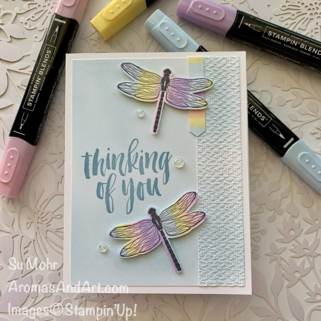 By Su Mohr for Fusion; Click aromasandart.com to go to my blog for details! Featuring: Dragonflies Bundle, Rooted In Nature, Stampin' Blends, Tasteful Textile Embossing Folder, Blending Brushes, Opal Rounds; #rainbowsoncards #rootedinnature #dragonfliesbundle #dragonflygarden #dragonflies #rainbows #handmadecards #handcrafted #diy #cardmaking #papercrafting #stamping #stampinup #cardchallenges