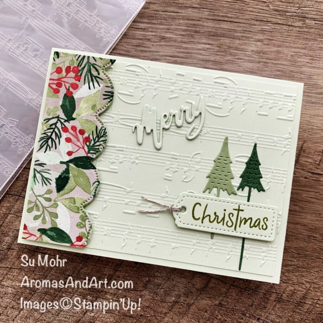 By Su Mohr; Click aromasandart.com to go to my website for instructions! Featuring: Merry Melody Embossing Folder, Painted Christmas Designer paper, Scalloped Contours Dies, Tailor Made Tags Dies, Word Wishes Dies; #paintedchristmas #merrymelody #scallopedcontours #wordwishes #paperwords#musiconcards#christmastrees ##christmascards #holidaycards #holiday2021 #handmadecards #handcrafted #diy #cardmaking #papercrafting #sumohr #aromasandart.com/shop #stampinup #caseings