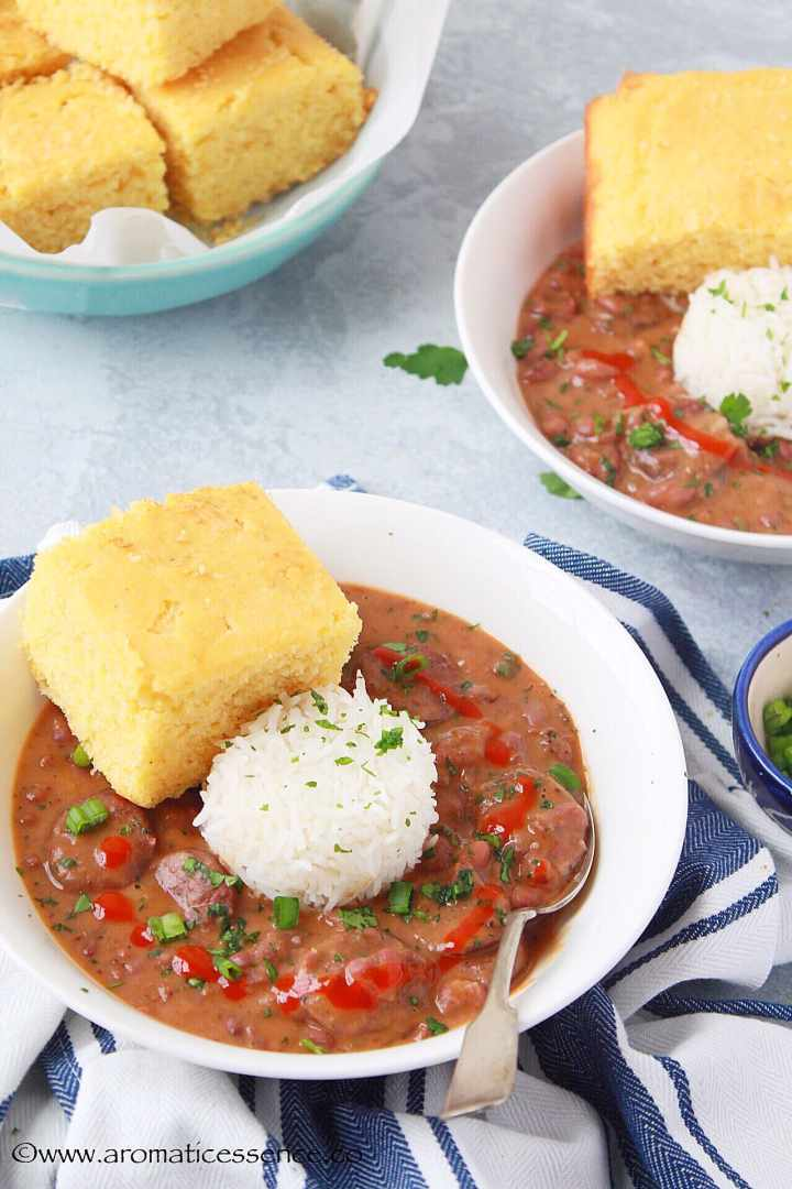 Instant Pot Red Beans in a bowl with a scoop of rice and cornbread
