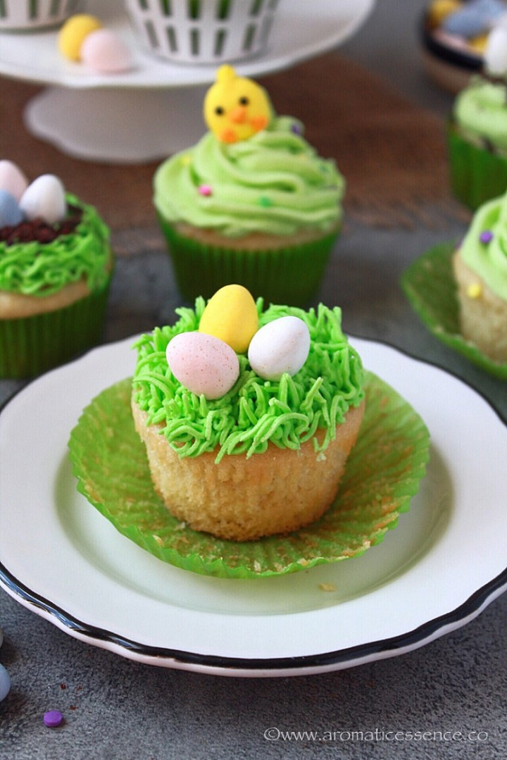 Eggless Easter cupcakes frosted with buttercream icing and topped with chocolate eggs