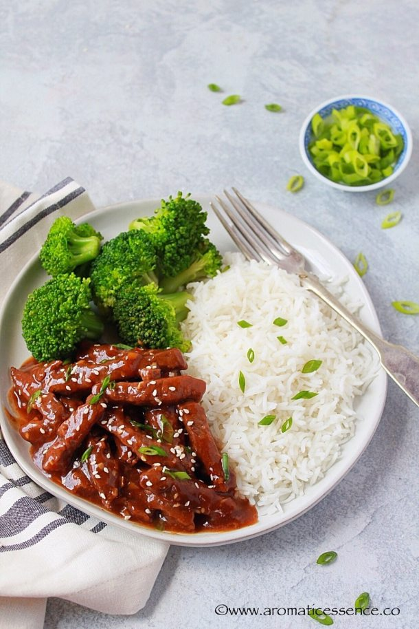 Mongolian Beef served in a white rimmed plate