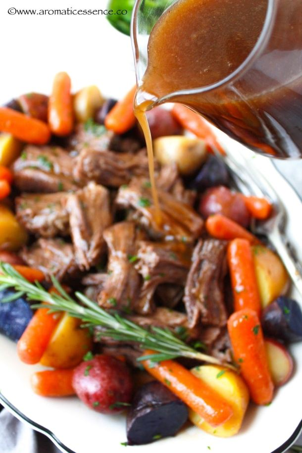 Pouring gravy over shredded beef pot roast