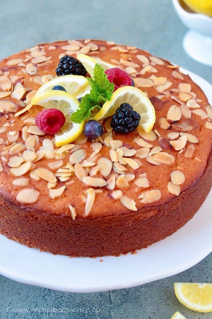 Lemon ricotta cake on a white cake stand
