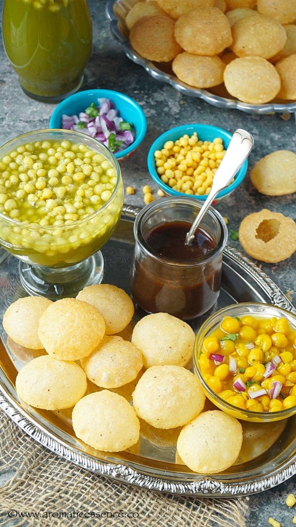 Puris, spicy pani, ragda, and sweet chutney on a platter
