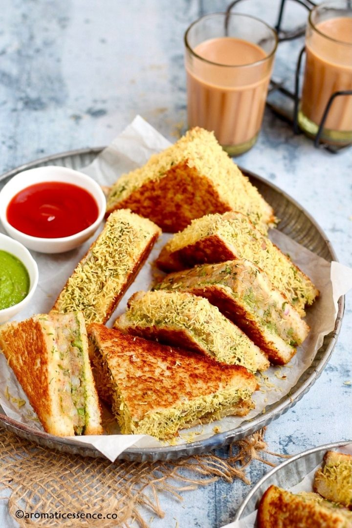 $5 degree shot of aloo toast sandwiches served in a galvanized metal tray