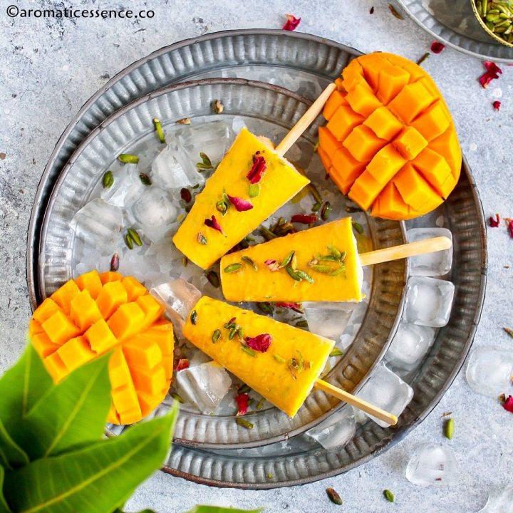 Homemade mango kulfi served in galvanized metal tray