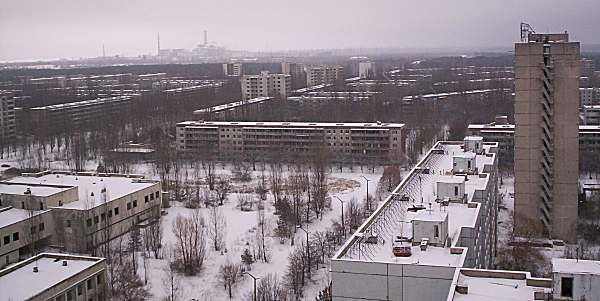 We stood atop one of Pripyat's high-rise apartment buildings and wondered at how close Chernobyl-4 was (top left)...
