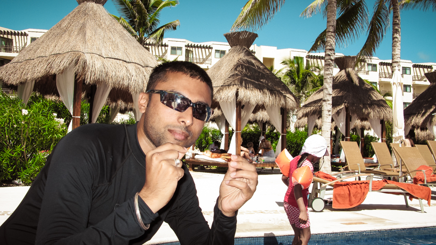 Sukh Enjoys Chicken Wings Poolside