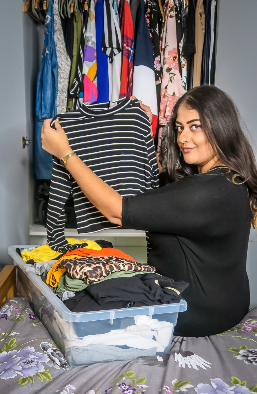 What To Wear In The Morning - Amrit holds up a black stripy top
