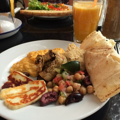 Scrambled eggs, hummus, grilled aubergine and Halloumi cheese