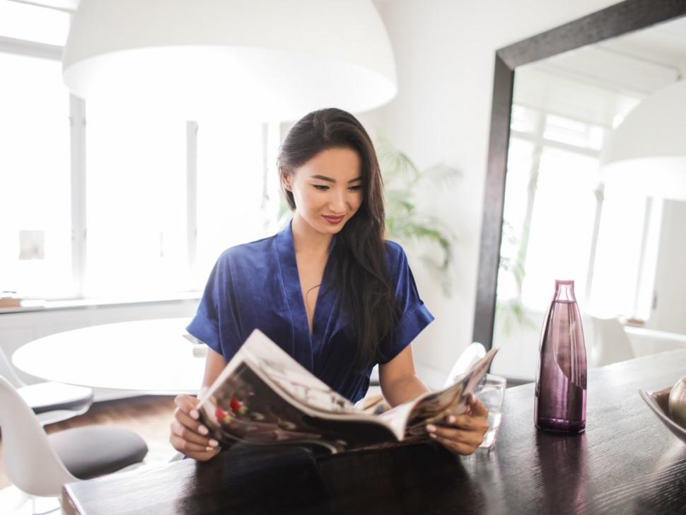 woman-in-blue-dress-reading-magazine-3755830