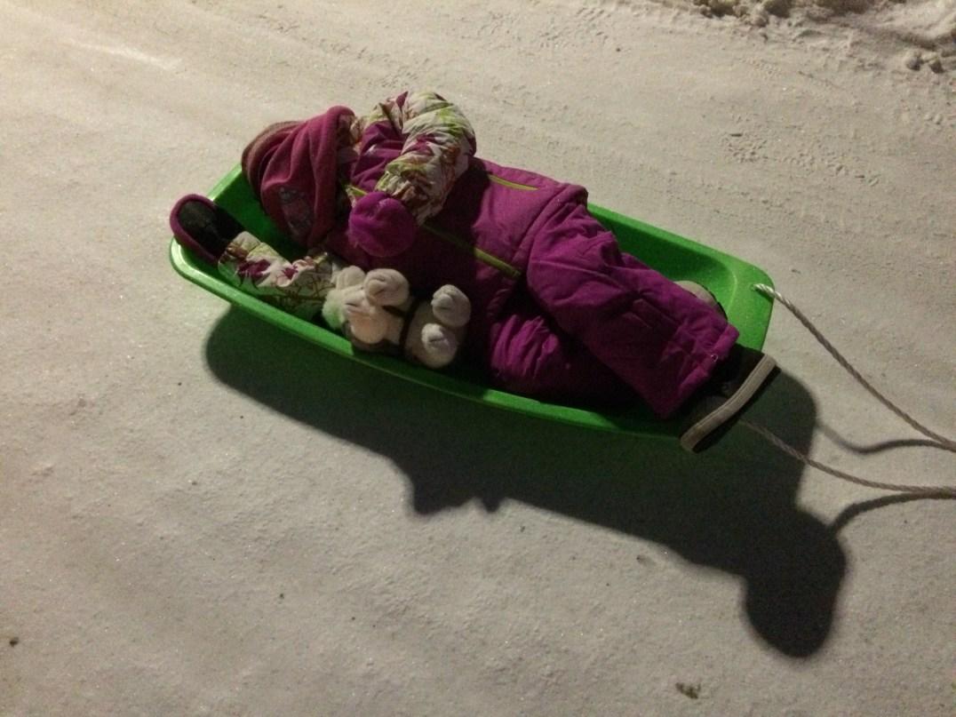 Taking a nap on a sledge at Santa Claus Village in Rovaniemi, Finland