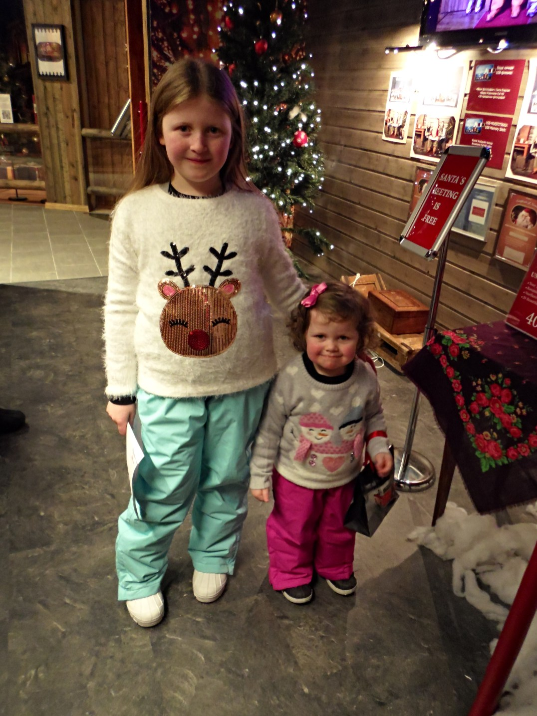 Lily-Belle and Matilda wait to see Santa Claus at the Santa Claus Holiday Village in Rovaniemi, Finland