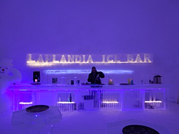 Mikko serves hot Glögi at the Laplandia Ice Bar in Rovaniemi, Finland