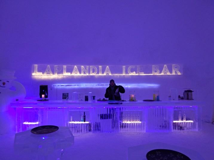 Mikko serves hot Glögi at the Laplandia Ice Bar in Rovaniemi, Finland