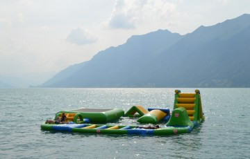 Inflatable assault course floating in Lake Brienz at Camping Aaregg, Switzerland