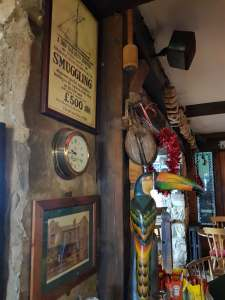 Artwork and Artifacts on the walls at Smugglers Creek Inn