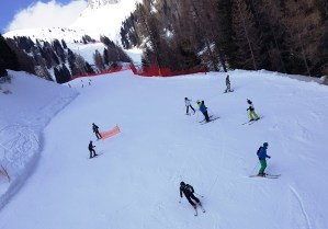 Skiers and Snowboarders at Ski Center Latemar in the Val di Fiemme, Trentino, Italy