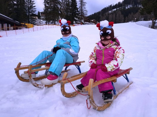 Lily-Belle and Matilda ready for tobogganing at Obereggen