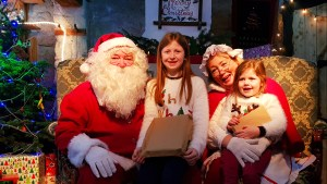 Lily-Belle and Matilda meet Santa and Mrs Claus at the Days of Christmas Past tour at Ulster American Folk Park