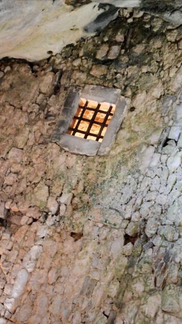 A dimly lit window at Predjama Castle, Slovenia