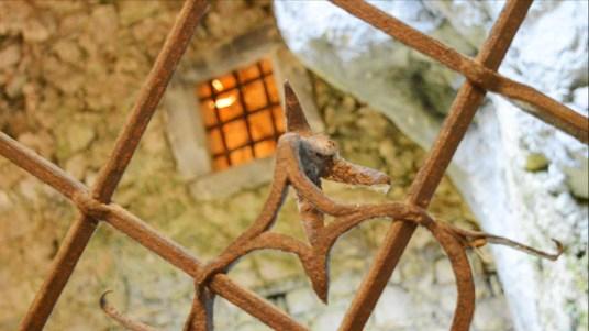 Lit window at Predjama Castle, Slovenia