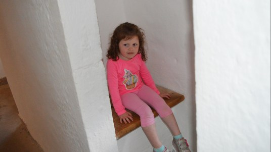 Sitting on the Royal throne at Predjama Castle, Slovenia