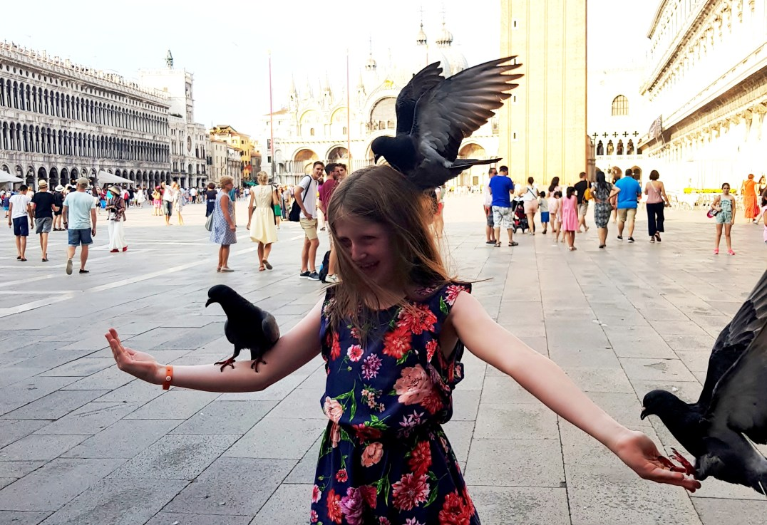 Feeding pigeons in Piazza San Marco in Venice