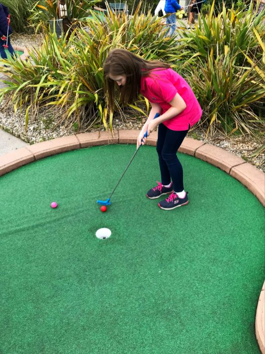 Putting for a birdie at Pirates Adventure Golf, Dundonald