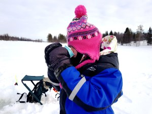 Drinking hot berry juice and Ice Fishing at Ruka Lake in Finland