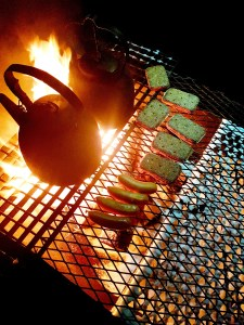 Sausages sizzle at the Starlit Sleigh Ride camp fire