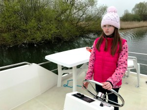 Lily-Belle navigating the Crusader on the River Thames