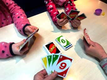 Playing Uno on board the Crusader on the River Thames