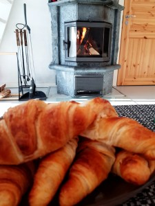 Croissants by the fire at A Cosy Cottage by the River in Rovaniemi