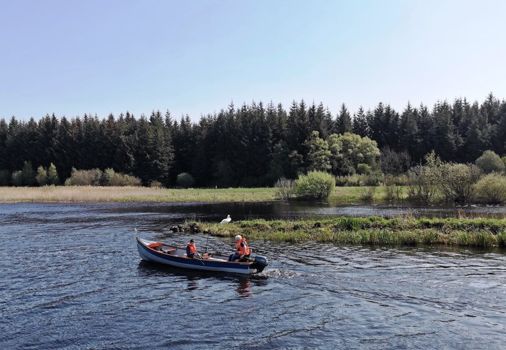 Fishing from a boat on the River Shannon