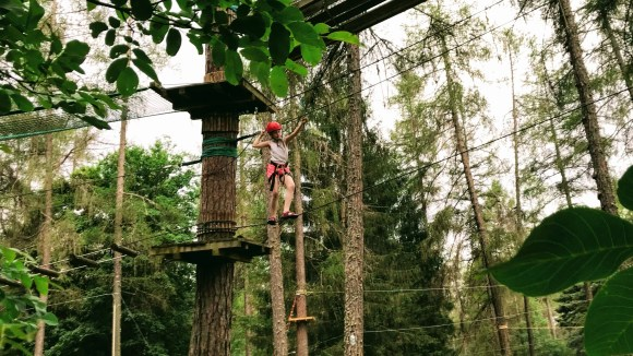 Lily-Belle navigating the Aerial Assault Course at Acropark Adventure Dolomiti