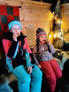 Eating traditional Finnish biscuits at Vaaran Porotila, Ranua