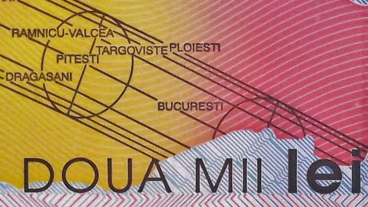 closeup detail from Romania 2000 Lei Banknote back, featuring romanian cities in path of total solar eclipse