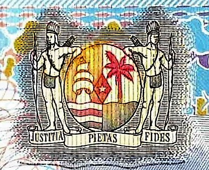 closeup detail from Suriname 5 Guden Banknote, Year 2000 front, featuring coat of arms