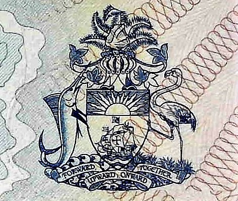 closeup detail of The Bahamas 1 Dollar Quincentennial Banknote, Year 1992 back, featuring coat of arms with dolphin and flamingo