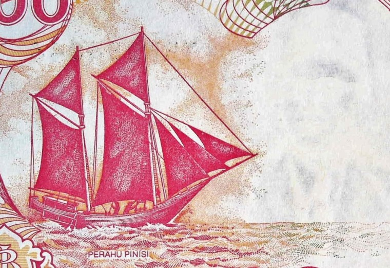 closeup detail of Indonesia 100 Rupiah Banknote, Year 1992 fron, featuring sailing ship at sea