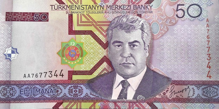 Turkmenistan 50 Manat 2005 banknote front, featuring President Saparmurat Niazov. and the Turkmen coat of arms