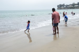 Running around in the cold Pacific Ocean