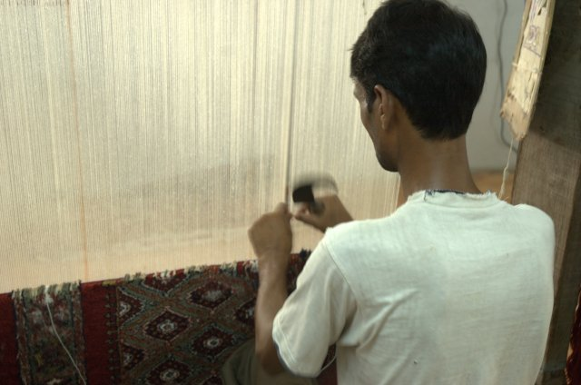 "Watching traditional carpet making in Agra, which we would not have seen without our taxi driver taking us to his ""friend"""
