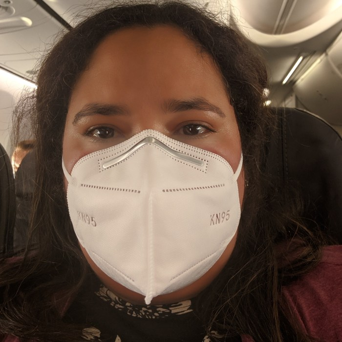 Woman wearing an N95 Mask on an airplane