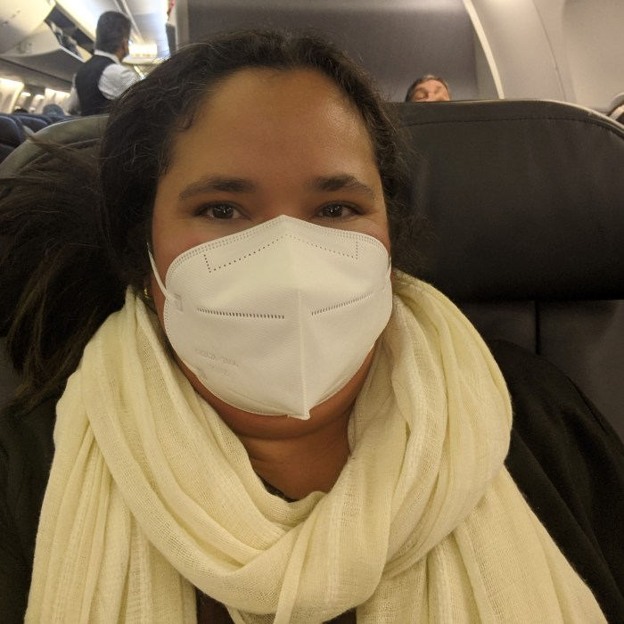 Woman in a N95 face mask on a plane