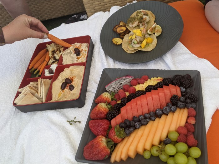 Snacks from the Sandbar Grille including a fruit tray, a Mediterranean platter, and shrimp tacos
