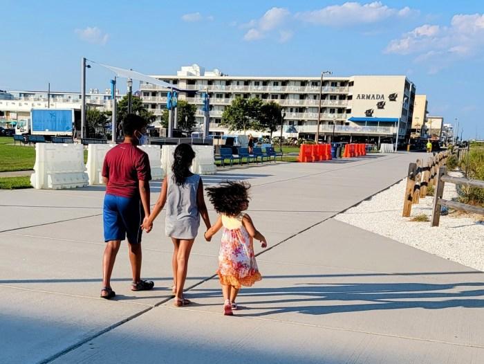 3 children walking along the walkway in Wildwood Crest