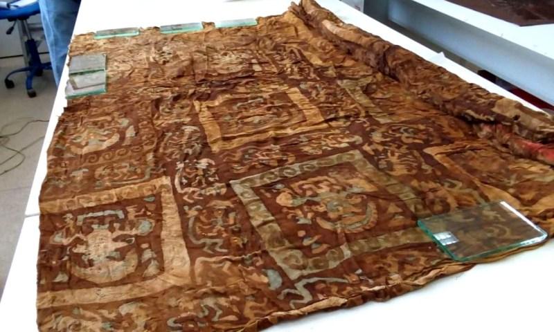 Las imágenes divinas en textiles de menores sacrificados, son inéditas en Perú